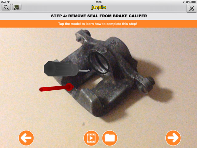 The fourth and final step in disassembling a rear brake caliper is to remove the piston seal from the caliper.