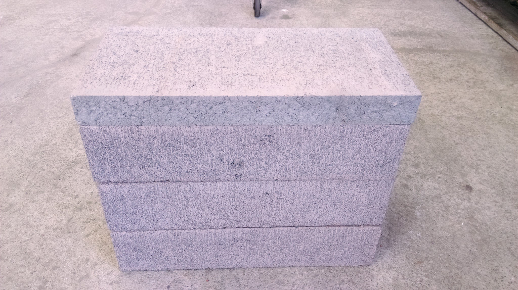 Three masonry blocks with cap.