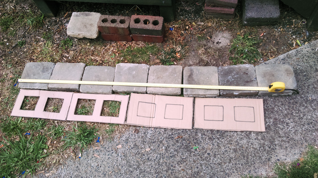 Using cardboard masonry block proxies to determine how many flat bricks would be needed as foundation for the ledge.