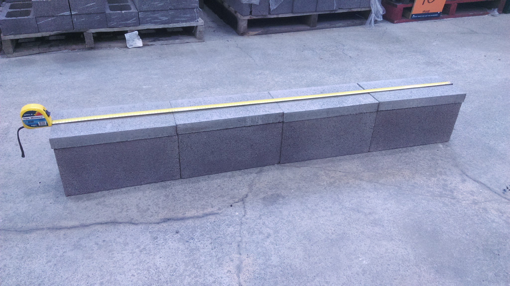 Four blocks with caps. Not to low in height and not too high in cost (considering the likelihood of the ledge being demolished).